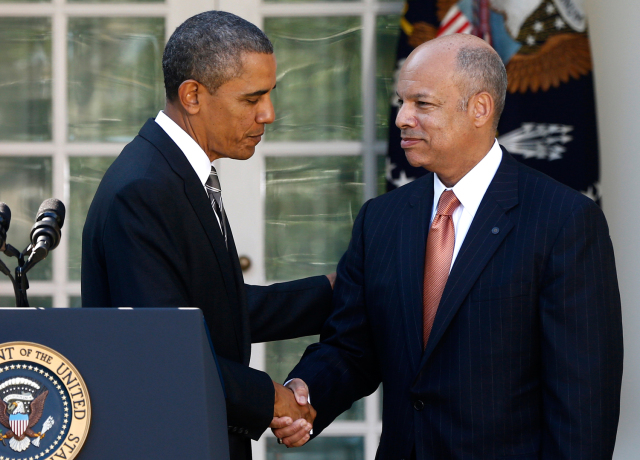President Barack Obama shakes hands with Jeh Johnson, his choice for the next Homeland Security Secretary, in the Rose Garden at the White House in Washington, Friday, Oct. 18, 2013. Johnson was general counsel at the Defense Department during the wars in Iraq and Afghanistan. (AP Photo/Charles Dharapak)